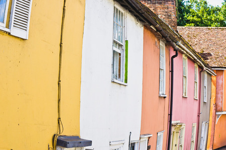 neighbours: Row of colorful town houses in Sudbury, UK Stock Photo