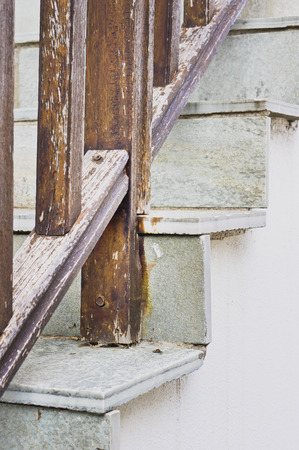 bannister: Stone steps with a weathered wooden bannister Stock Photo