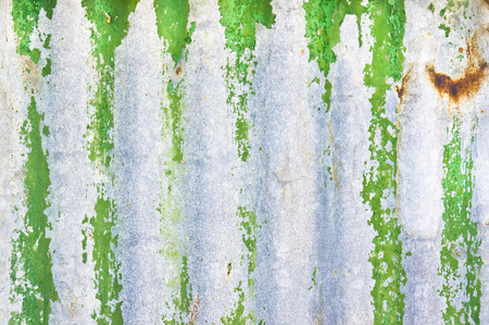 metal sheet: Part of a green corrugated metal sheet as a background