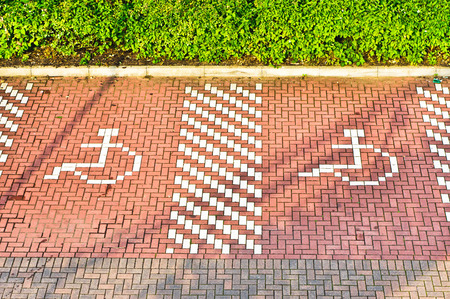 parking spaces: Parking spaces with disabled icons Stock Photo