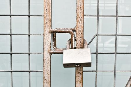 keep gate closed: A metal gate locked Stock Photo