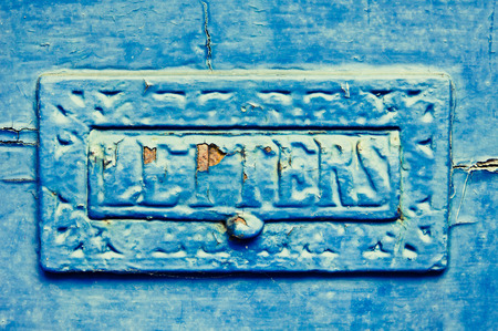 old metal: An old metal letterbox painted blue with peeling paint and rust