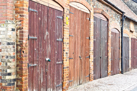 A Row Of Old Wooden Garage Doors Stock Photo Picture And Royalty