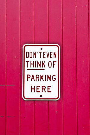 sarcastic: A sign forbidding parking on a wooden background