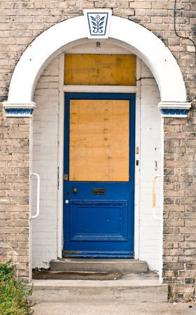 boarded: A boarded up blue front door
