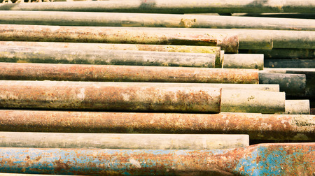 metal bars: Stack of rusty metal bars as a background Stock Photo