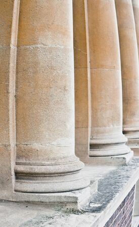neo classical: Row of large stone pillars on an urban building Stock Photo