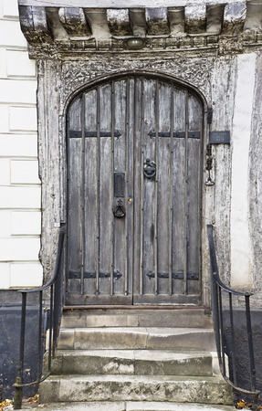 english house: A wooden door in an old english house Stock Photo