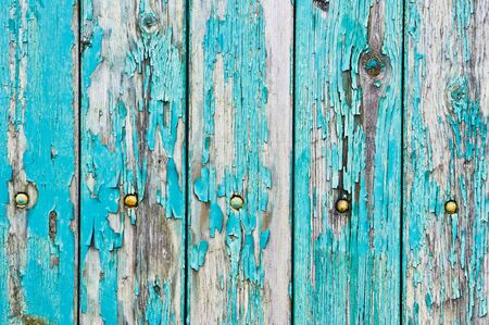 exfoliate: Weathered blue wood as a background