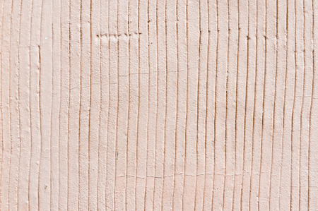 grooves: Part of a stone surface with grooves in it, as an abstract texture