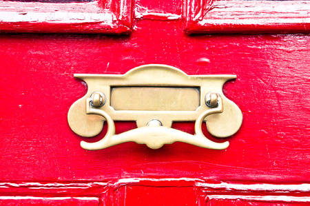 letterbox: A metal letterbox in a red wooden door Stock Photo
