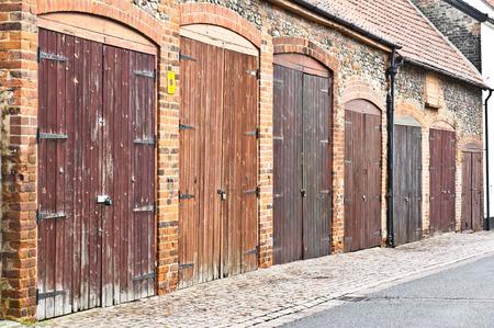 garage doors: A row of old wooden garage doors