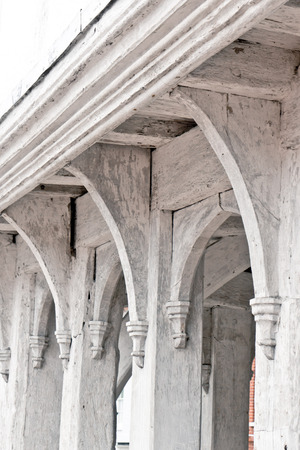 wooden beams: White painted wooden beams on an old english building