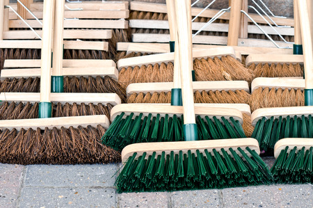 brooms: Selection of new wooden brooms at a market Stock Photo