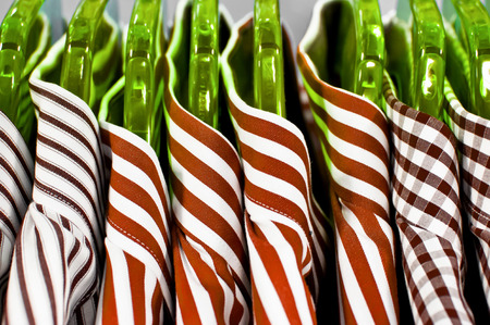 hangers: Stylish mens shirts hanging on green hangers