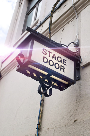 back lighting: A sign for a stage door at a London theatre, with back lighting and lens flare