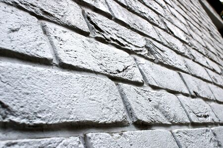Low down perspective of a brick wall, with a shallow depth of field