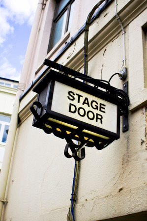 A sign for a stage door at a London theatre