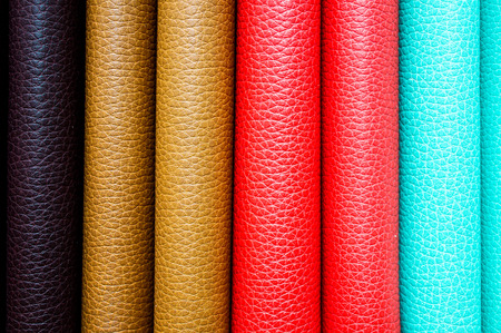 leather background: Colorful leather binding of stacked books, as a background image