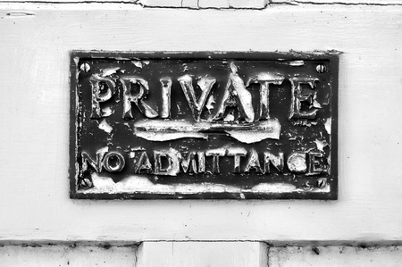 admittance: An old sign stating private and no admittance, in black and white tones