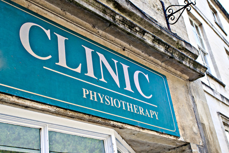 sector: Part of a sign at a physiotherapy clinic in the UK