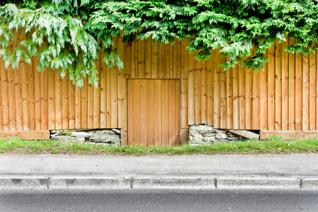 land locked: A fence with a low down gate next to a road uin the UK