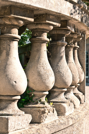 Part of a classic weathered stone wall with sulptured pillars