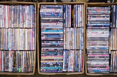 discs: ELGIN, SCOTLAND - OCTOBER 8 2015: Large selection of pre-owned DVDs at a charity shop in Elgin.