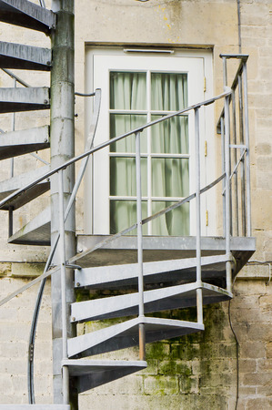 emergency stair: Metal spiral stairs forming an emergency exit route on the outisde of a building
