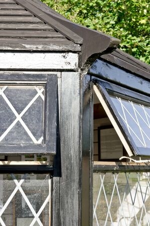 conservatory: Lattic windows in part of a conservatory with black wooden beams