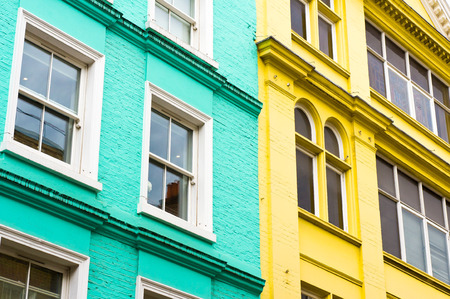townhouses: Blue and yellow adjoining London townhouses