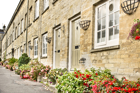 town houses: Row of town houses in Cirencester UK with colorful garden displays