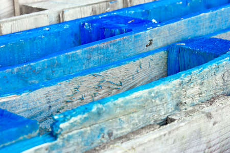duckboards: The top of stacked blue wooden crates, as a background pattern