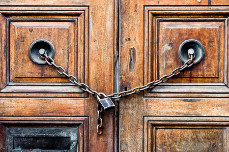 chained: A double wooden door chained closed