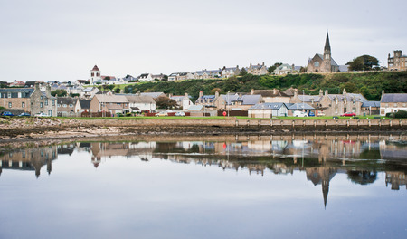 A view of Lossiemouth, Scotland across the estuary at high tide on an autumn day