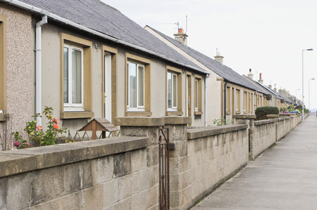 architecture bungalow: A row of bungalows on a street in Lossiemouth, Scotland