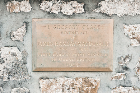 macdonald: LOSSIEMOUTH, SCOTLAND - OCTOBER 9 2015: An engraved stone sign on the outside of the birthplace home of Ramsay Macdonald, Britians first Labour party prime minister.