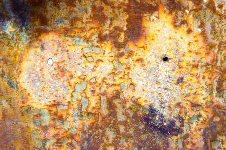 severely: Part of a severely rusted metal surface as a background Stock Photo