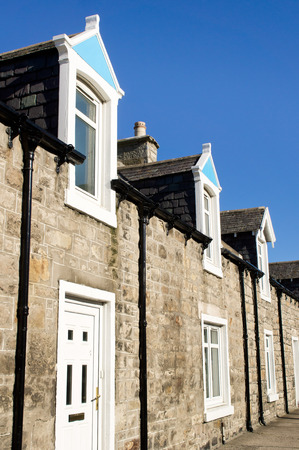 room to let: Terraced bungalows with attic rooms in a scottish town Stock Photo
