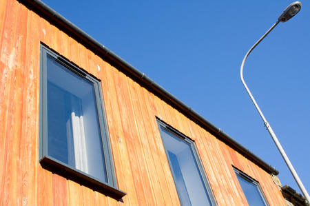 eco building: Wooden cladding on the exterior of a modern eco building in Scotland