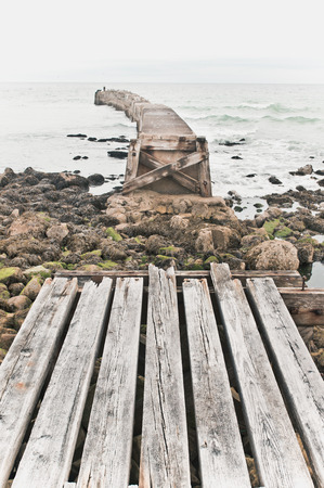 incomplete: An old wooden walkway at the coast in Scotland, which is incomplete Stock Photo