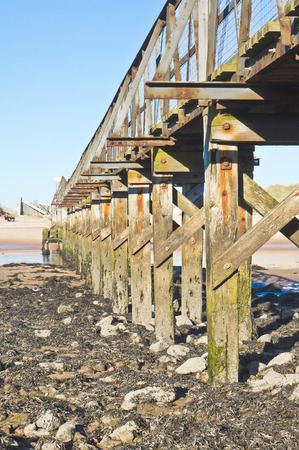 estuary: Details of a wooden walkway over the estuary at Lossiemouth in Scotland Stock Photo