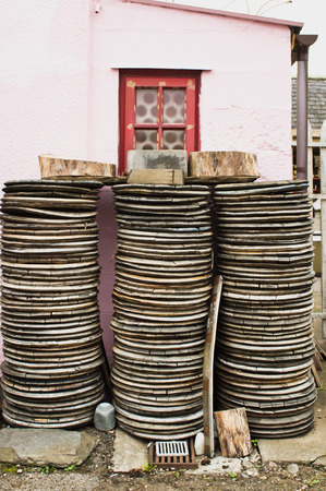 discs: Piles of wooden discs outside a small pink cottage in Scotland