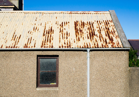 architecture bungalow: A rusty corrugated metal roof on an out buidling in Scotland Stock Photo