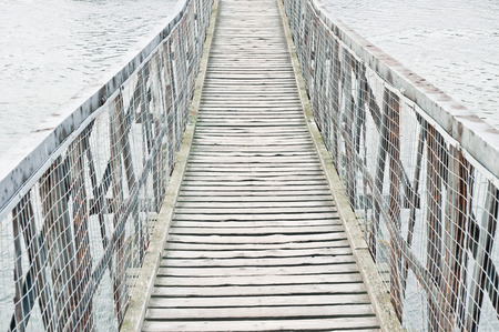 bridge over water: Part of a wooden bridge over water