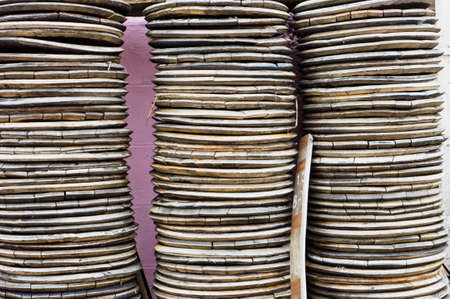 discs: Piles of wooden discs, as a detailed background image Stock Photo