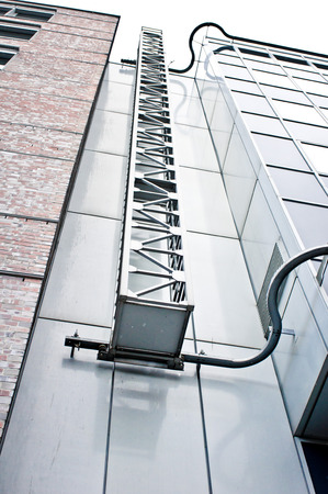 building sector: An access ladder on the exteior of adjoining modern buildings in Germany Stock Photo