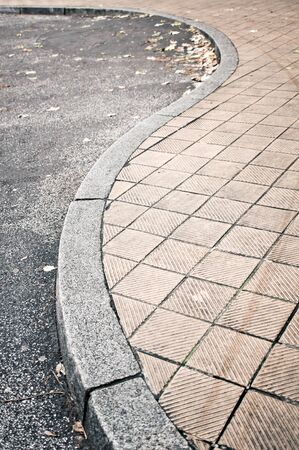 kerb: Part of a curved pavement next to a road