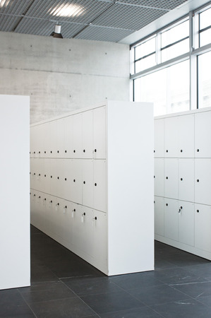 safekeeping: Modern white lockers in a public building Stock Photo