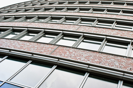 building sector: Dramatic persppective of part of a tall urban brick building in Berlin